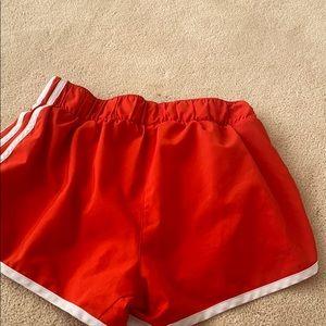 Red Adidas exercise shorts